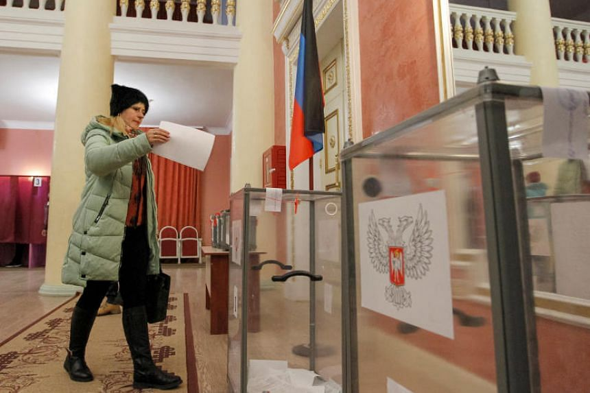 """Voters headed to polling stations amid tightened security in the Donetsk and Lugansk """"People's Republics"""" in Ukraine's industrial east on Nov 11, 2018."""