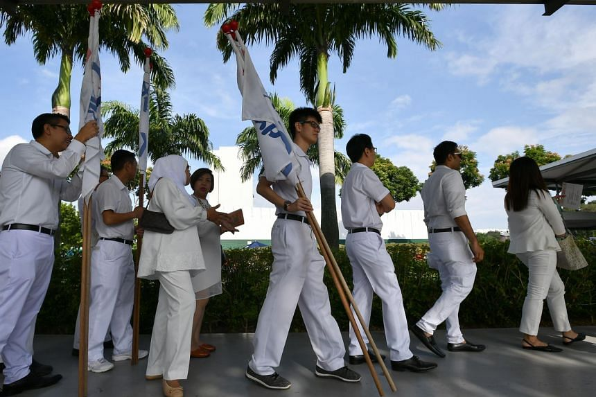 Party members queuing to enter the PAP Conference and Awards Ceremony at Singapore Expo, Hall 8 on Nov 11, 2018. ST PHOTO: LIM YAOHUI