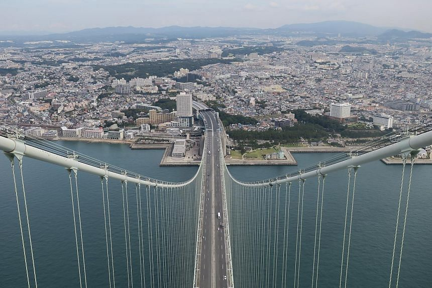 A view of Kobe's 4km-long Akashi-Kaikyo bridge. The bridge's two towers stand nearly 2km apart in what is the world's longest suspension bridge span. It connects Kobe to Awaji Island across the Akashi Strait, an international sea lane with about 1,40