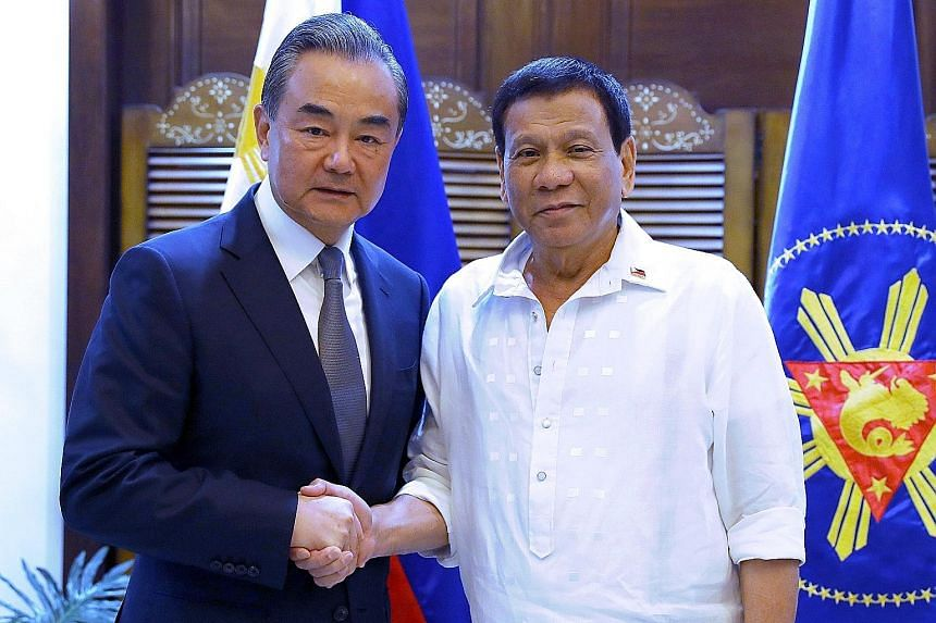 Chinese Foreign Minister Wang Yi with Philippine President Rodrigo Duterte in Davao City last month, during Mr Wang's two-day visit to the Philippines for a series of bilateral meetings and signing of agreements.