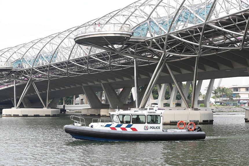 Left: Police officers checking out the Marina coastal area ahead of the summit. Right: Marina Reservoir patrol boats will ply the waters around the Marina Barrage, Singapore River and Kallang Basin during the summit.