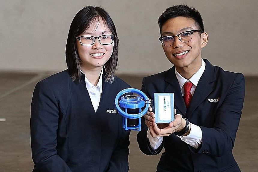 Republic Polytechnic's Azimah and Jordan Sia with their invention - a locked pill dispenser that helps patients keep track of the medication they take daily. Ms Heng Yin Qi and Mr Lee Wei Juin from SP with Shaky - a device that can be attached to obj