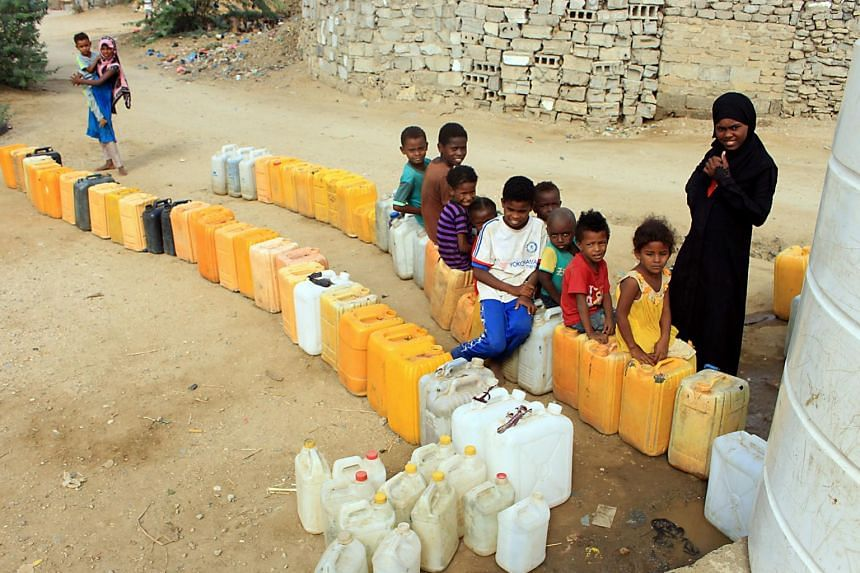 Displaced children from Hodeidah province wait for water supplies in a camp in the northern district of Abs in Yemen, on Nov 10, 2018.