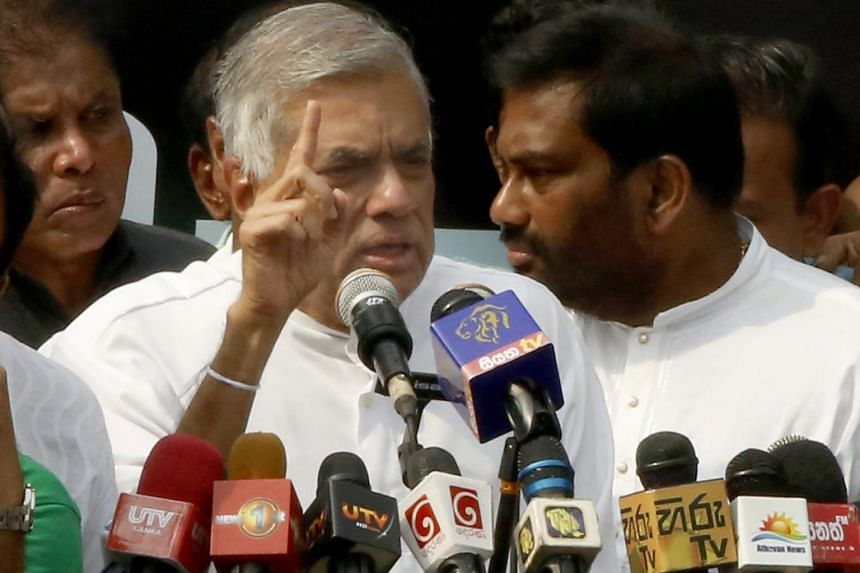 Former Sri Lankan Prime Minister Ranil Wickremesinghe addresses his supporters and the media during a rally near the Prime Ministerial residence of the Temple Trees in Colombo, Sri Lanka, on Oct 30, 2018.