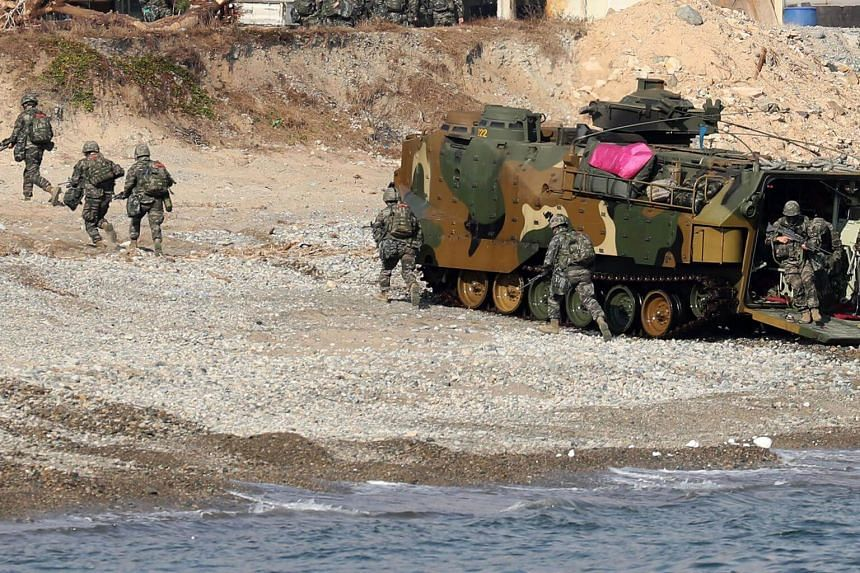 South Korean Marines exit an amphibious assault vehicle during a landing operation in the southern city of Pohang, on Nov 5, 2018.