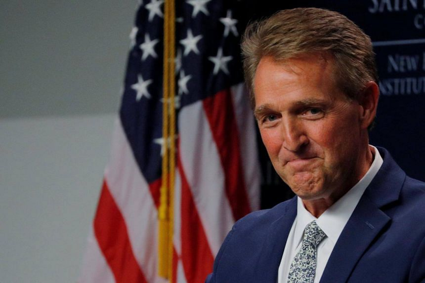 US Republican Senator Jeff Flake speaks at the Institute of Politics at Saint Anselm College in Manchester, New Hampshire, on Oct 1, 2018.