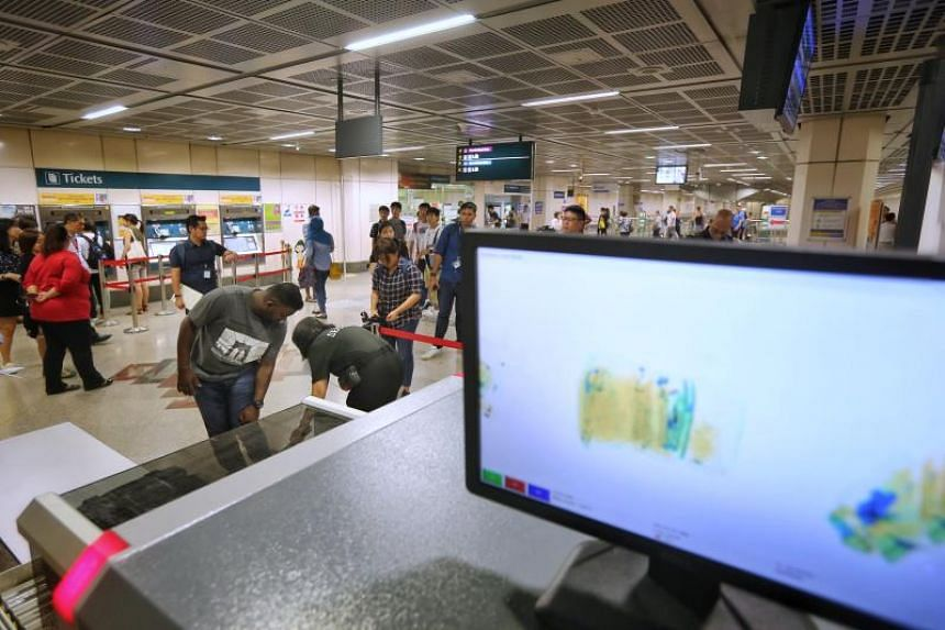 Some commuters were required to walk through a metal detector and pass their belongings through X-ray scanners before entering the fare gates at Little India MRT station on Nov 12, 2018.