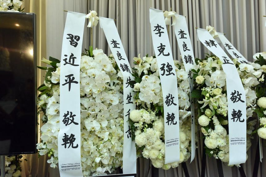 White flower wreaths displayed prominently in the parlour include those from members of the Chinese government, including President Xi Jinping and premier Li Keqiang.