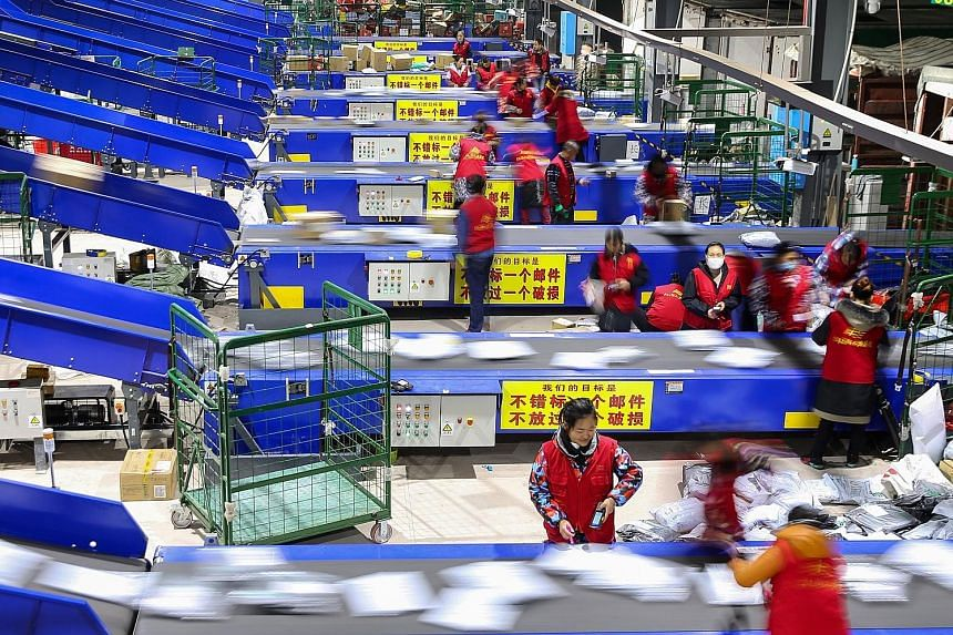 Workers sorting packages after the Singles' Day shopping festival at a delivery company in Hengyang in China's central Hunan province. At the stroke of midnight on Monday, e-commerce giant Alibaba said it had racked up a record US$30.8 billion (S$42.