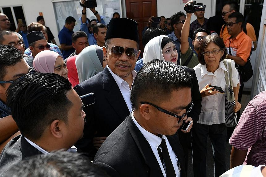 Shahidan Kassim (in sunglasses), former minister in the Prime Minister's Department, arriving yesterday at the Kangar Sessions Court in Perlis to face a charge of molesting an underage girl. The MP for Arau pleaded not guilty and was released on bail