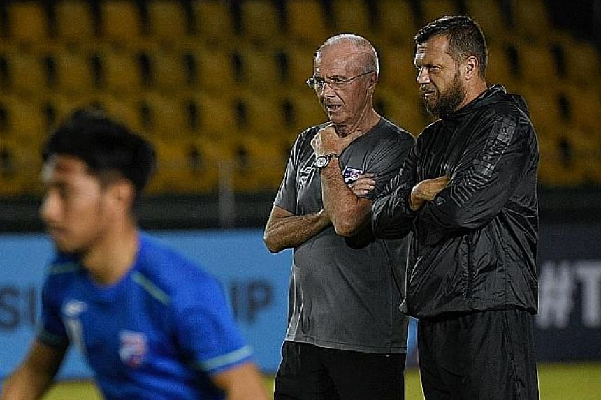 Philippines head coach Sven-Goran Eriksson and assistant coach Scott Cooper overseeing training at the Panaad Stadium in Bacolod City yesterday, ahead of their AFF Suzuki Cup opener against Singapore today.