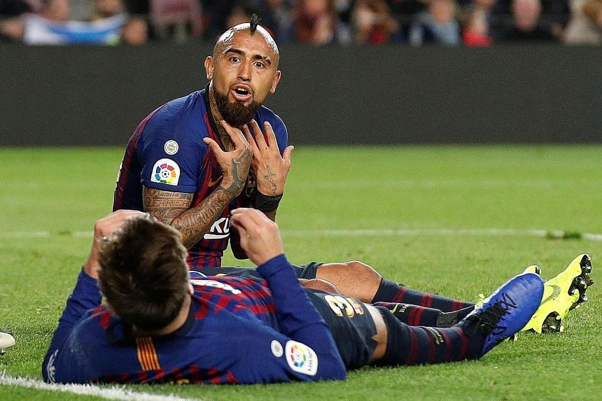 Barcelona's Gerard Pique (back to camera) and Arturo Vidal remonstrating after a missed chance in their 4-3 home defeat by Betis.