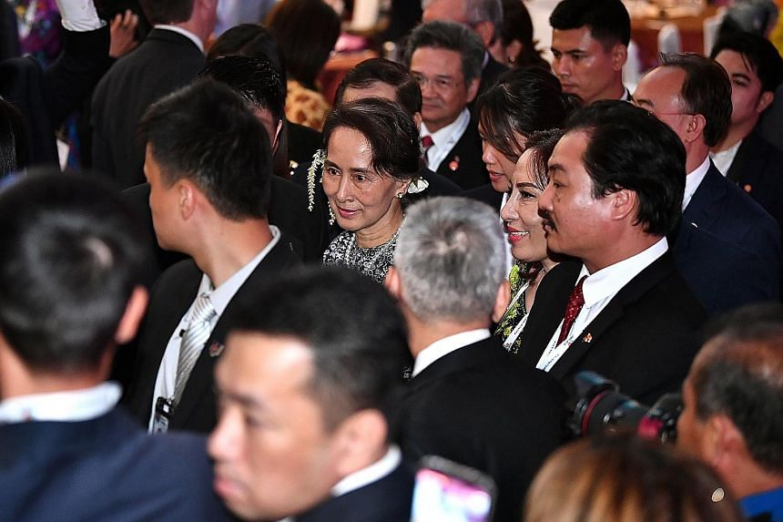 Myanmar's State Counsellor Aung San Suu Kyi taking her leave after making a keynote speech at the Asean Business and Investment Summit yesterday. She told regional policymakers and business leaders that reforms have been undertaken to make her countr