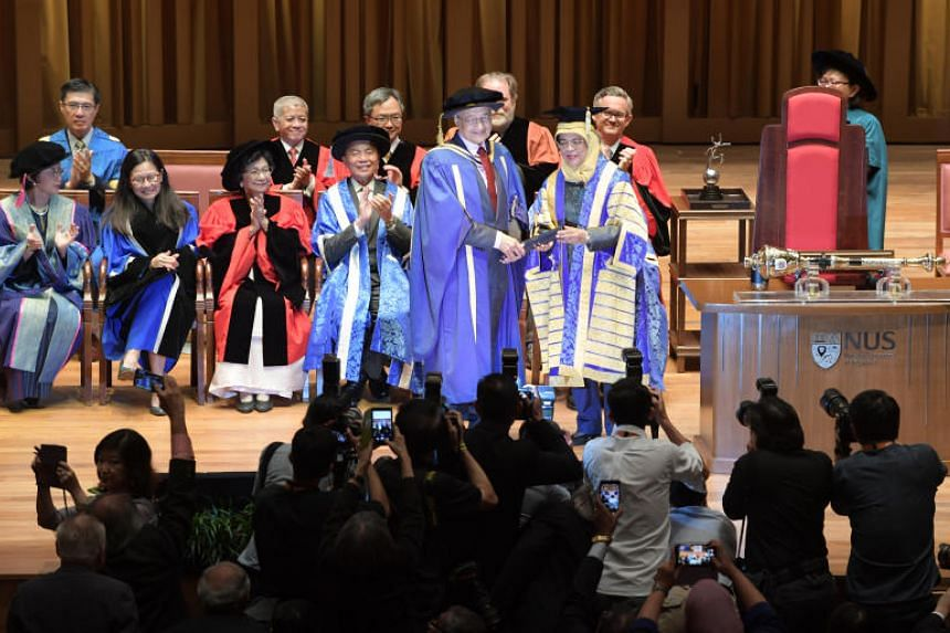 President Halimah Yacob, Chancellor of the National University of Singapore, confers on Prime Minister of Malaysia Tun Dr Mahathir Mohamad the Honorary Doctor of Laws at a ceremony held at the Yong Siew Toh Conservatory of Music on Nov 13, 2018.