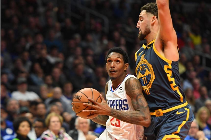 d070e05ce Lou Williams reeled off 10 of his points in overtime to secure victory  after the Los