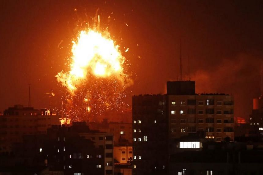 A ball of fire above the building housing the Hamas-run television station al-Aqsa TV in the Gaza Strip during an Israeli air strike on Nov 12, 2018.