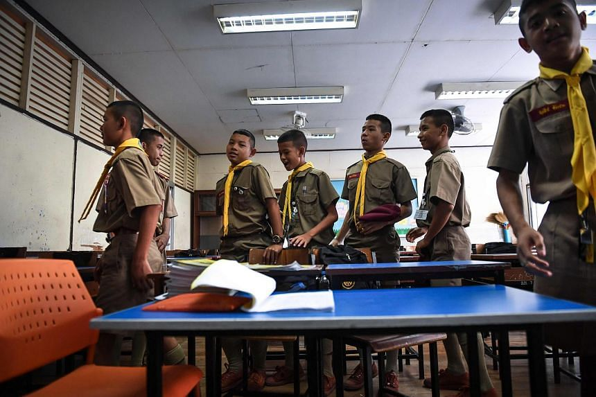 Students leaving a classroom after a music club session founded by 17-year-old rapper Elevenfinger at a government school in Bangkok, Thailand on Nov 8.