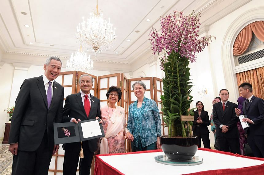 Prime Minister Lee Hsien Loong and Mrs Lee with Malaysian Prime Minister Mahathir Mohamad and his wife Siti Hasmah Mohamad Ali at the naming ceremony of the orchid Dendrobium Mahathir Siti Hasmah - a cross between Dendrobium Kiyoshu Blue and Dendrobi