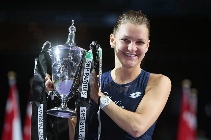 Radwanska poses with the Billie Jean King trophy in Singapore in 2015 after defeating Petra Kvitova of the Czech Republic in the WTA Finals.