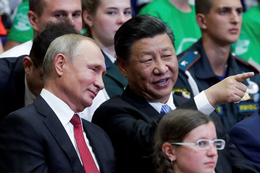 Russian President Vladimir Putin (left) and Chinese President Xi Jinping at an event in Vladivostok, Russia, Sept 12, 2018.