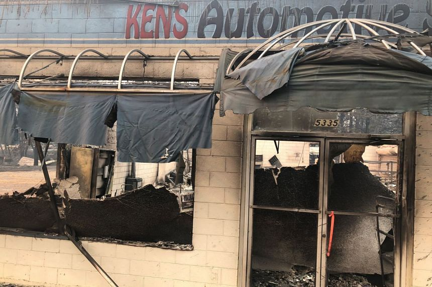 Ken's Automotive Service repair shop lies in ruins after wildfires devastated the area in Paradise, California.
