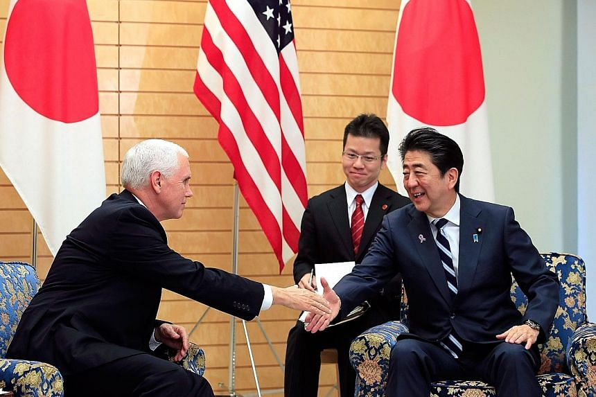 United States Vice-President Mike Pence with Japanese Prime Minister Shinzo Abe at the start of their meeting at the Prime Minister's official residence in Tokyo yesterday.