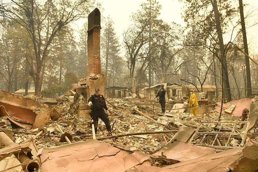 Alameda County Sheriff Coroner officers searching for human remains at a burnt-down residence in Paradise, California, on Monday. More personnel were set to join in the search for victims of the Camp Fire blaze across the charred landscape of Paradis