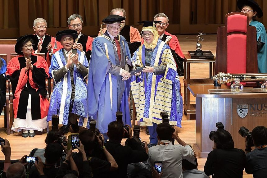 Tun Dr Mahathir and his wife, Tun Dr Siti Hasmah Mohamad Ali, speaking with an old friend, Dr Sundrai Lily Sarma, after the ceremony. Singapore President and NUS Chancellor Halimah Yacob conferring the honorary doctorate in law on Malaysian Prime Min