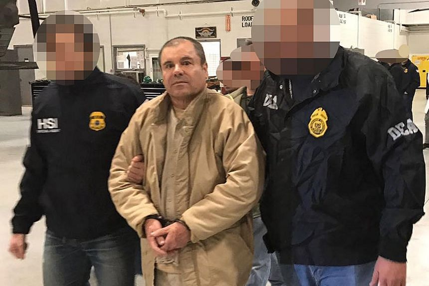 File photo of Joaquin Guzman Loera aka 'El Chapo' Guzman being escorted in Ciudad Juarez by the Mexican police as he is extradited to the United States, on Jan 19, 2017.