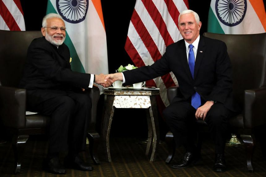 a85e64b4858 Indian Prime Minister Narendra Modi shakes hands with US Vice-President  Mike Pence at their