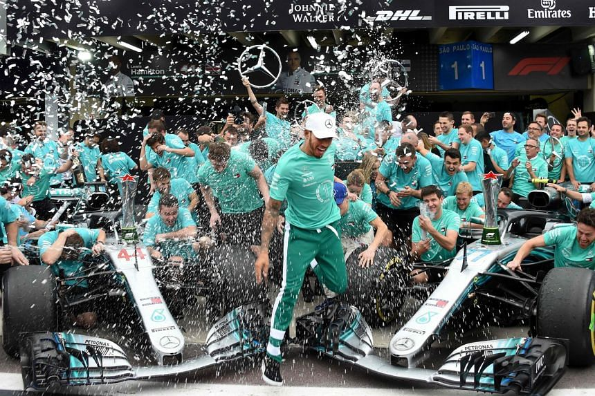 Five-times world champion Hamilton (centre) celebrates with the Mercedes  team after winning ce9b4bfcb