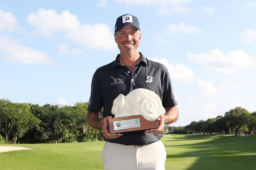 Matt Kuchar celebrates with the winner's trophy on the 18th green after the final round of the Mayakoba Golf Classic at El Camaleon Mayakoba Golf Course on Nov 11, 2018.