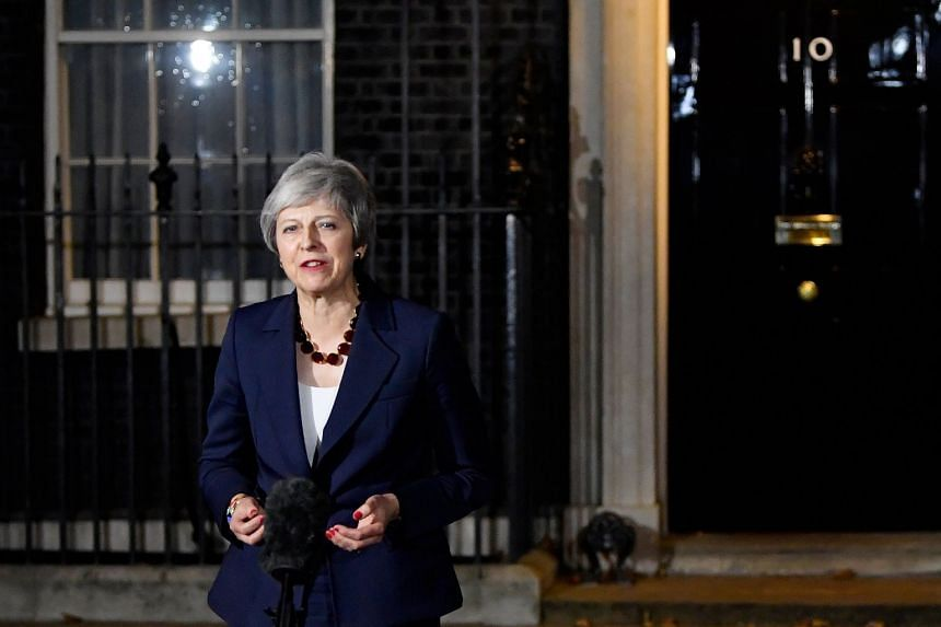 Theresa May makes a statement outside 10 Downing Street, in London.