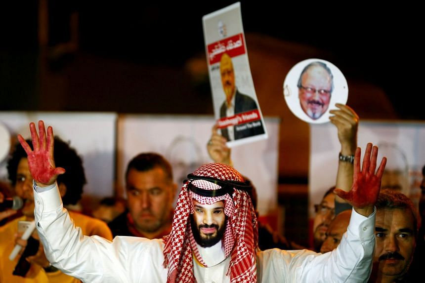A protester wearing a mask of Saudi Crown Prince Mohammed bin Salman outside the Saudi Arabia consulate in Istanbul, Turkey.