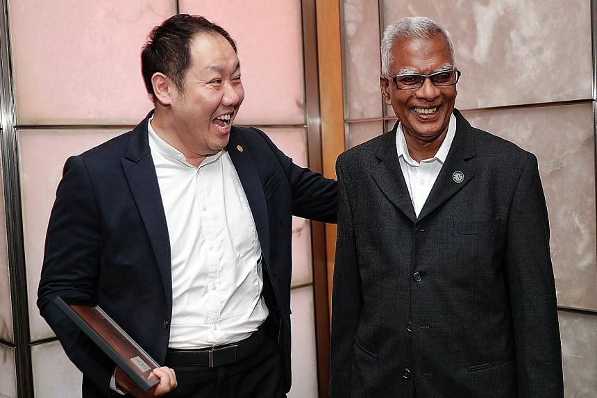 Assigned solicitor Siaw Kin Yeow (left), 48, and Mr Ramasamy Palanisamy at the Legal Aid Bureau's 60th anniversary dinner yesterday.
