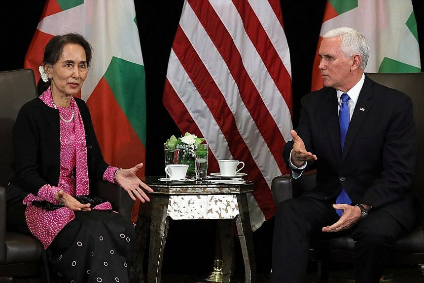 """Myanmar's de facto leader Aung San Suu Kyi and United States Vice-President Michael Pence at a meeting yesterday. He condemned the """"violence and persecution"""" against the Rohingya as """"without excuse"""", and said he was """"anxious to hear about the progres"""