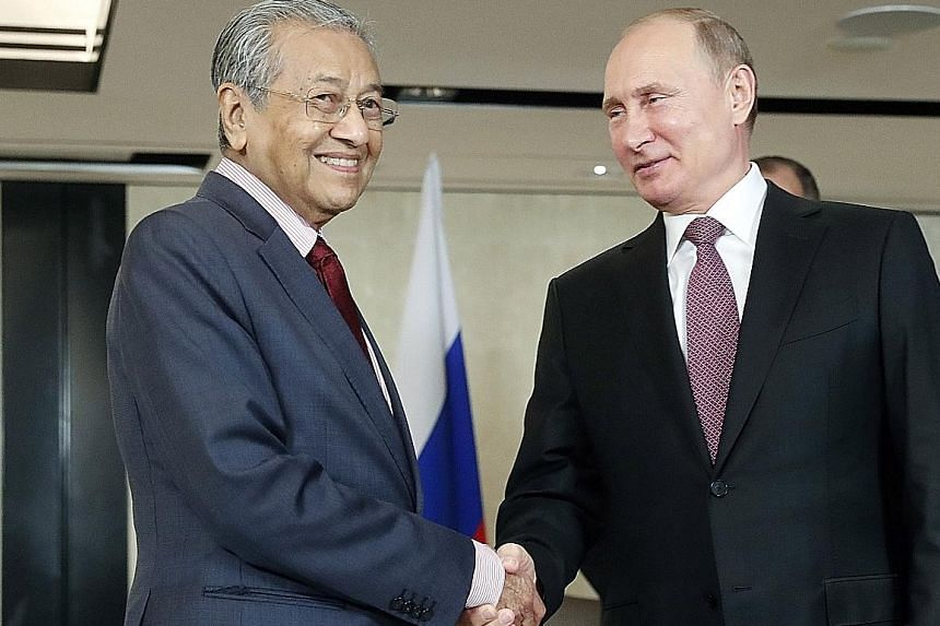 Malaysian Prime Minister Mahathir Mohamad and Russian President Vladimir Putin at a meeting on Tuesday on the sidelines of the Asean Summit.