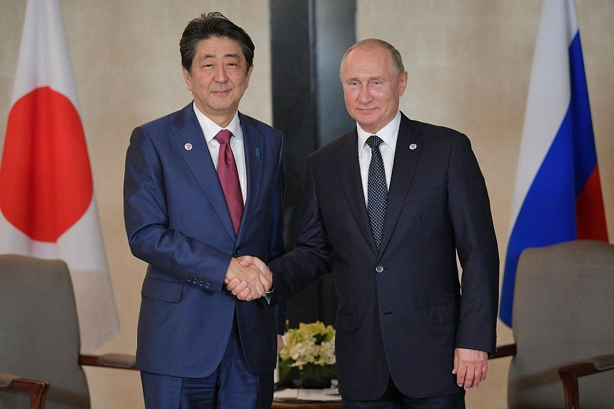 Japanese Prime Minister Shinzo Abe (left) and Russian President Vladimir Putin attend a meeting on the sidelines of the ASEAN-Russia Summit on Nov 14, 2018.