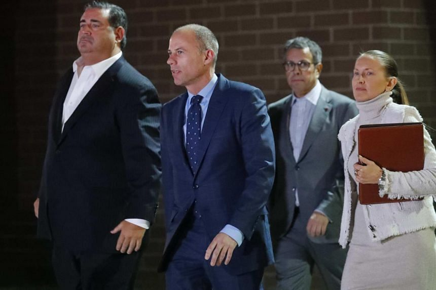 Michael Avenatti (centre) leaves Los Angeles Police Department Pacific Division after being arrested on suspicion of domestic violence, in Culver City, California, on Nov 14, 2018.