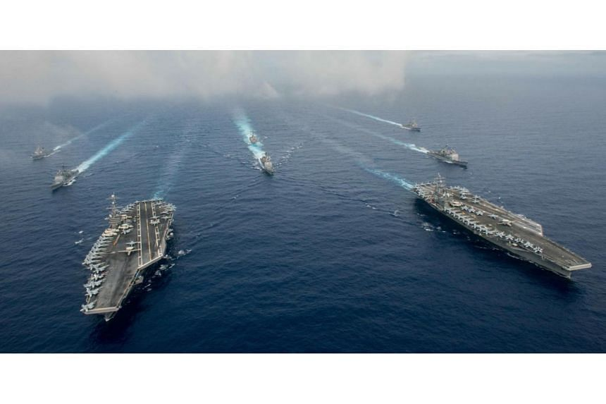 US carriers join up in East Asia for 'complex' warfare drills, East