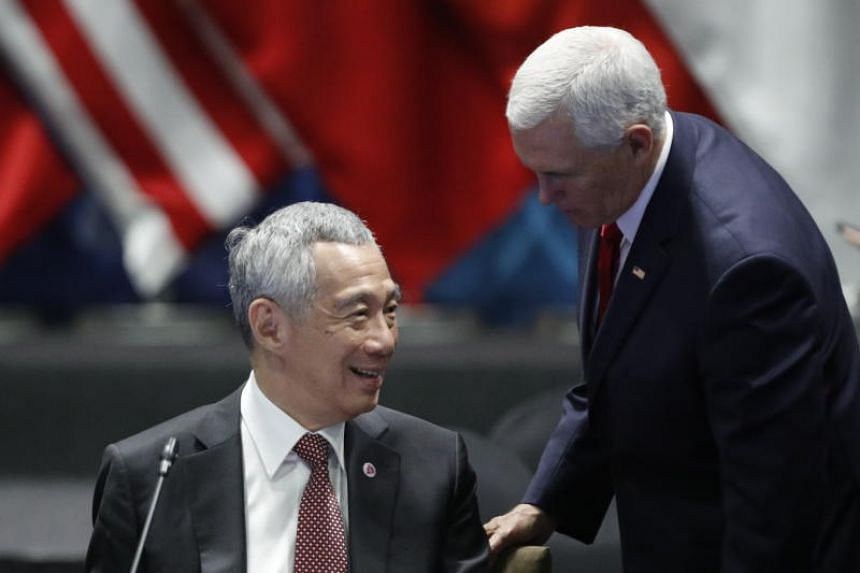 Prime Minister Lee Hsien Loong and US Vice-President Mike Pence chat during the 13th East Asian Summit in Singapore on Nov 15, 2018.