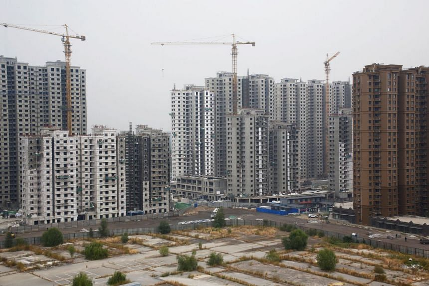 A construction site of residential apartment blocks in Beijing, China. Beijing, Shanghai, Shenzhen and Guangzhou posted no change in their average monthly prices.