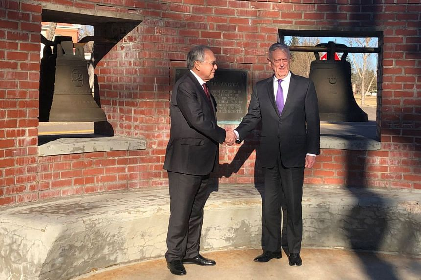 US Defense Secretary Jim Mattis (right), shakes hands with Philippines Ambassador Jose Manuel Romualdez commemorating the US decision to return the Bells of Balangiga to the Philippines at FE Warren Air Force Base, Wyoming, on Nov 14, 2018.