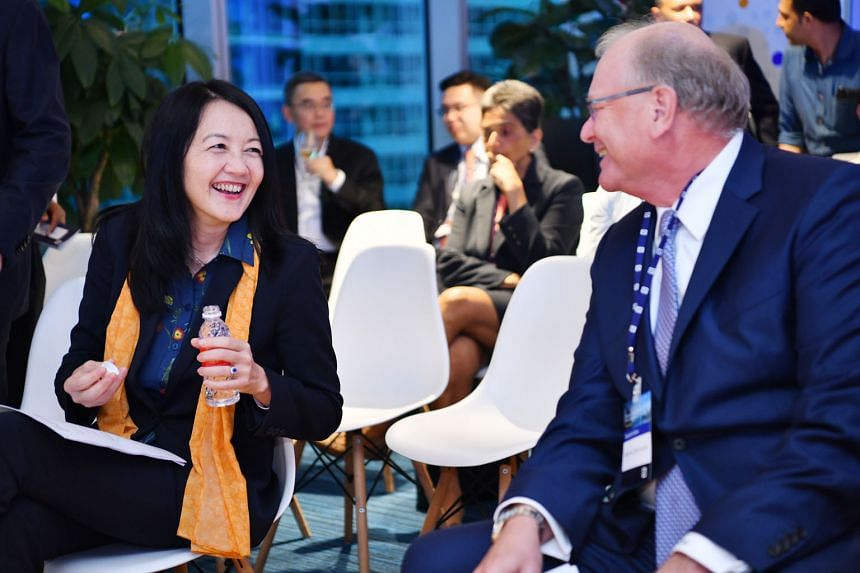 MAS deputy managing director Jacqueline Loh with Deutsche Bank CEO for Asia-Pacific Werner Steinmueller at yesterday's launch.