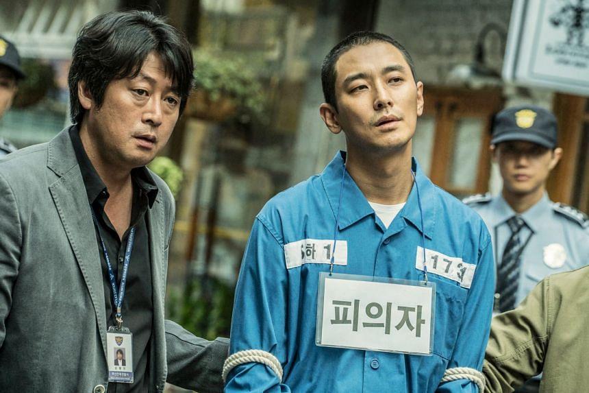 Dark Figure Of Crime stars Kim Yoon-seok (left) as a detective and Ju Ji-hoon as a convicted murderer.