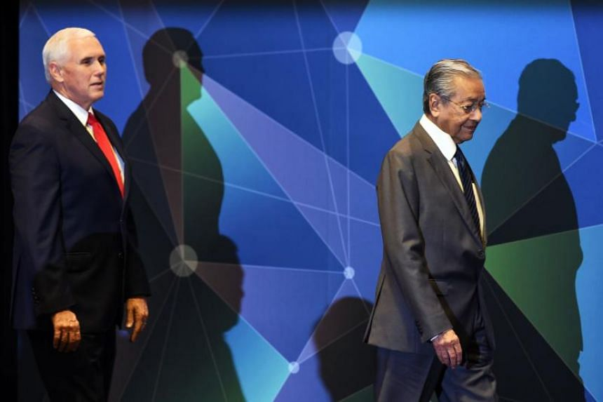 US Vice-President Mike Pence and Malaysian Prime Minister Mahathir Mohamad at the start of the Asean-US summit in Singapore on Nov 15, 2018.