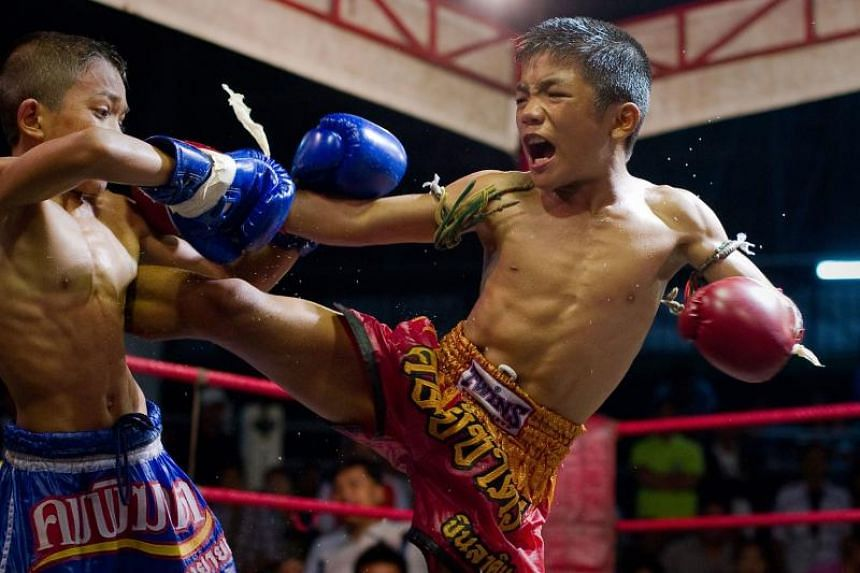 Young Muay Thai boxers fighting in the ring at a boxing stadium in Buriram province in 2012. New research within Thailand suggests that the earlier Muay Thai boxers begin, the more prone they are to a range of injuries.