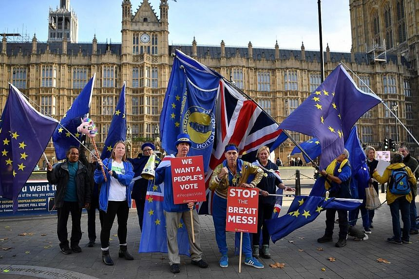 Anti-Brexit demonstrators waving the Union Jack and the European Union flag outside Parliament in London on Wednesday.
