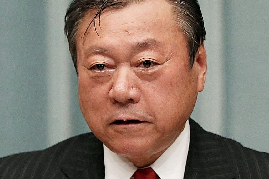 Mr Yoshitaka Sakurada, in Parliament on Wednesday, also appeared confused by the concept of a USB drive.