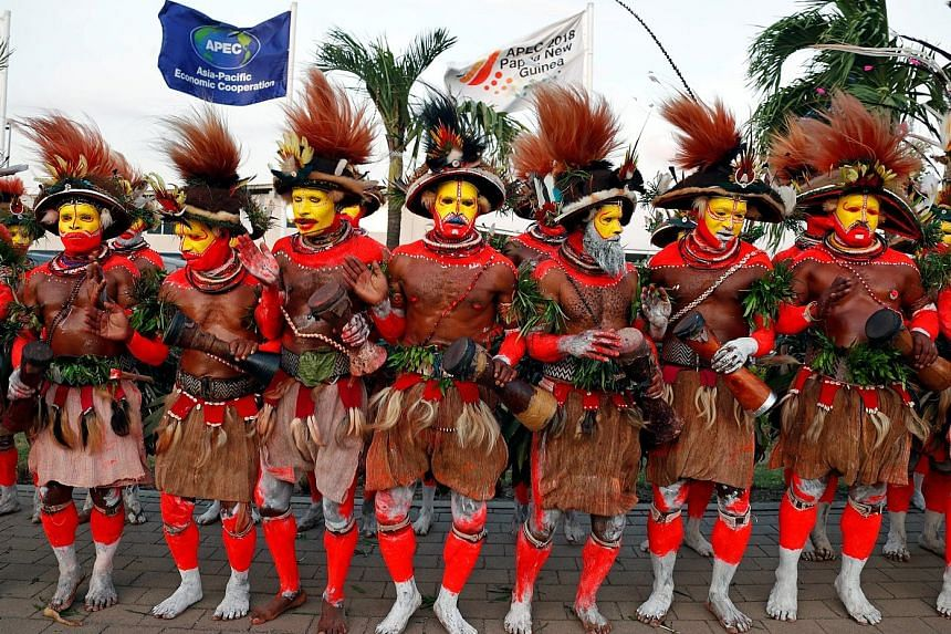 Papua New Guinea traditional dancers waiting for Chinese President Xi Jinping in Port Moresby yesterday. He arrived early to meet the heads of those Pacific countries that recognise China but not Taiwan.